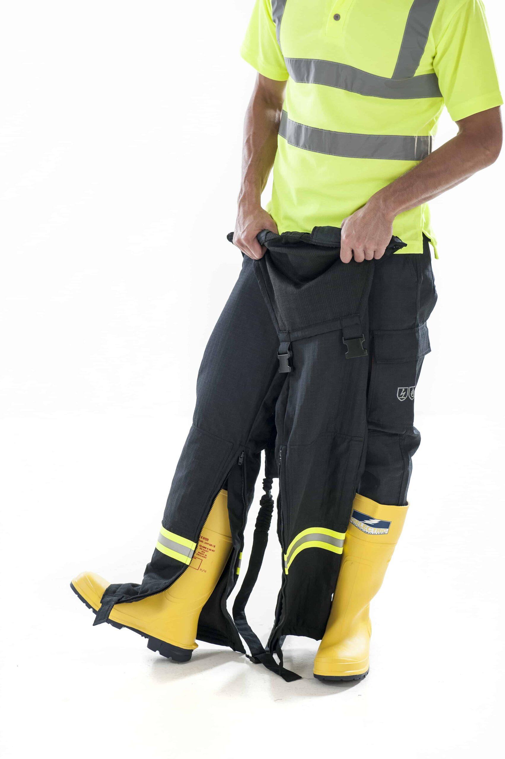 man putting on ArcBan® 2 Layer Bib Trouser